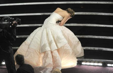 Jennifer Lawrence, stumbled on the stairs, with her spectacular Dior dress, going up to pick up her Oscar for 'The Good Side of Things', in 2013