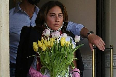 Lady Gaga crying and with a vase full of tulips