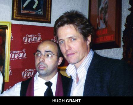 Hugh Grant, with a staff member