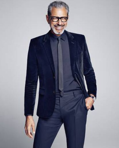 The interpreter of 'Independence Day: Counterattack' wears jacket, pants and glasses, everything, Saint Laurent by Hedi Slimane.  Tom Ford glasses and vintage tie.