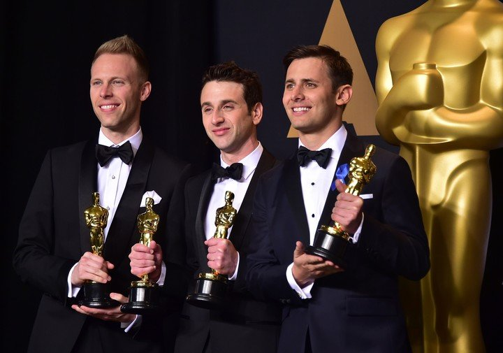 """Justin Paul and Benj Pasek - with Justin Hurwitz in the middle - won the Oscar for """"City of Stars"""", from """"La La Land"""", and they will compose the new songs for the film.  AFP photo"""