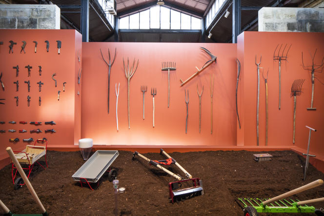 """""""Tools for an agroecological transition"""" in the foreground and a selection of old tools in the background."""