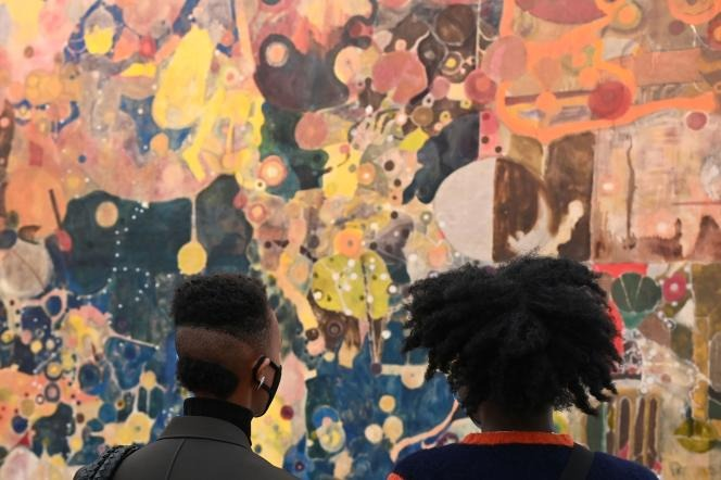 """Visitors watch Justin Caguiat's """"California"""" at the Frieze International Art Fair in London on October 14, 2021."""